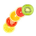 Fruit slices slice of orange grapefruit lemon tomato and kiwi on a white background Royalty Free Stock Photos
