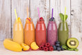Fruit smoothies variety in rainbow colors with fresh Royalty Free Stock Photo