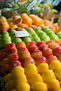 Fruit stands with signs and different fruits on them Royalty Free Stock Photo