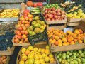 Fruit street market with different colored fresh fruits: apples, pears, persimmons, grapes Royalty Free Stock Photo