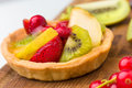 Fruit tart a tarts on wood background Stock Photos