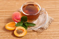 Fruit tea in cup with apricot foto for a design Stock Image