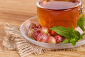 Fruit tea in cup with gooseberry package Royalty Free Stock Photography