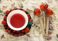 Fruit tea and strawberries red sugar on colorful background Stock Photography