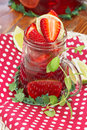 Fruit tea strawberry with fresh strawberries and lime Stock Photo