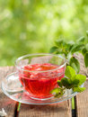 Fruit tea with strawberry in glass cup selective focus Stock Photos