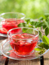 Fruit tea with strawberry in glass cup selective focus Stock Photography