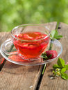 Fruit tea with strawberry in glass cup selective focus Royalty Free Stock Photo