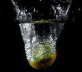 Fruit thrown in water launched various fruits Royalty Free Stock Images