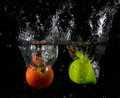 Fruit thrown in water launched various fruits Royalty Free Stock Image