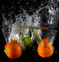 Fruit thrown in water launched various fruits Stock Image