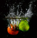 Fruit thrown in water launched various fruits Royalty Free Stock Photo