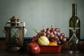 Fruit tray with a glass lamp on the table. Royalty Free Stock Photo