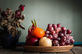 Fruit tray and vase of flowers. Royalty Free Stock Photo