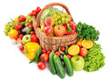 Fruit and vegetable in basket isolated on white background Stock Photos