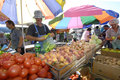 Fruit and vegetable sellers at the market Royalty Free Stock Photo