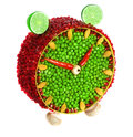 Fruit and vegetable volume clock on a white background Royalty Free Stock Images