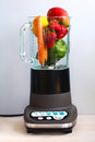 Fruit and vegetables in a food blender Royalty Free Stock Photos