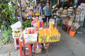 Fruit vendor in thailand sitting down with stand bangkok Royalty Free Stock Photo