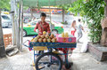 Fruit vendor in thailand sitting down with stand bangkok Royalty Free Stock Photography