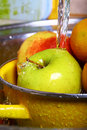 Fruit washing Royalty Free Stock Photography