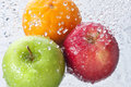 Fruit water drops spray food with falling all around Royalty Free Stock Photo