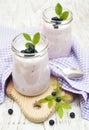 Fruit yogurt fresh with blueberries in glass jar Royalty Free Stock Photo
