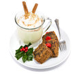 Fruitcake and eggnog isolated plate of christmas delicious frothy on white Royalty Free Stock Images