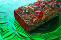 Fruitcake on glass plate Royalty Free Stock Photos