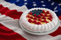 Fruitcake served in plate on American flag Royalty Free Stock Photo