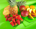 Fruits arrangement with strawberries pineapple and mangoes Stock Image