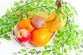 Fruits in basket Stock Images