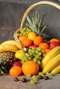 Fruits in a basket on grey background Royalty Free Stock Photo