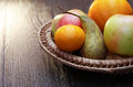 Fruits in basket set of various wicker on wooden table Stock Images