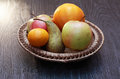 Fruits in basket set of various wicker on wooden table Royalty Free Stock Image
