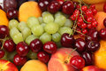 Fruits and berries green grapes red cherries currants ripe peach very tasty Royalty Free Stock Photography