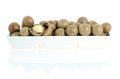 Fruits in bowl macadamia white on white background with reflection Stock Photos