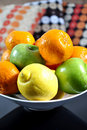 Fruits in a ceramic bowl Stock Photography