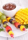 Fruits and chocolate sauce close up on Stock Image
