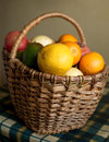 Fruits collected in brown wicker basket Stock Photos