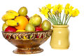 Fruits and daffodil in the metal bowl narcissus jonquilla in a ceramics flower pot isolated on white isolated with clipping path Royalty Free Stock Photography