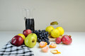 Fruits and jug with wine Royalty Free Stock Images