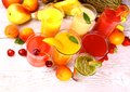 Fruits juice with cherry apricot kiwi pineapple and pear from top view Stock Photos