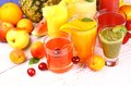 Fruits juice with cherry apricot kiwi watermelon and orange from top view Stock Images