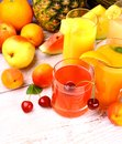 Fruits juice with cherry apricot and orange from top view Royalty Free Stock Images