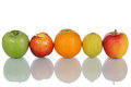 Fruits like oranges lemons and apples in a row isolated nectarines on white background Royalty Free Stock Image
