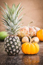 Fruits pineapple and on wooden background Stock Images