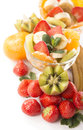 Fruits salad bananas kiwi and strawberry and glass bowl with fresh close up Stock Image