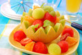 Fruits salad in melon bowl Royalty Free Stock Photo