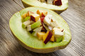Fruits salad in melon fresh summer half a sweet dessert Royalty Free Stock Image